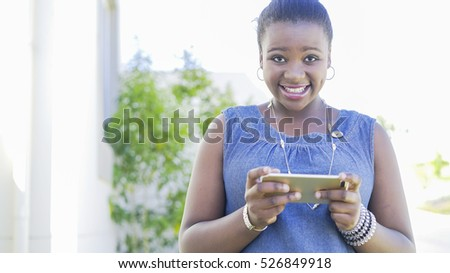 young African girl on phone