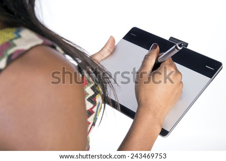 Young African girl using graphics tablet