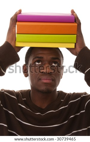 young african man holding color books over his head