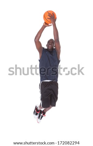 Young African Man Jumping With Basketball Over White Background - stock photo