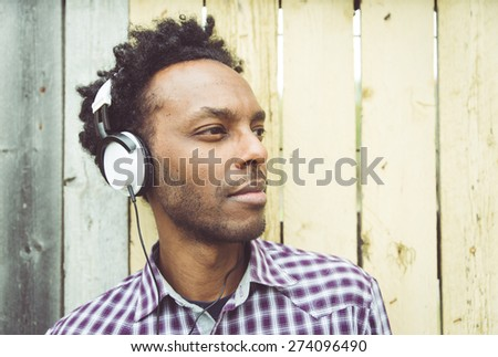 young african man listening to music. Concept about people, diversity,racism, youth, culture and people - stock photo