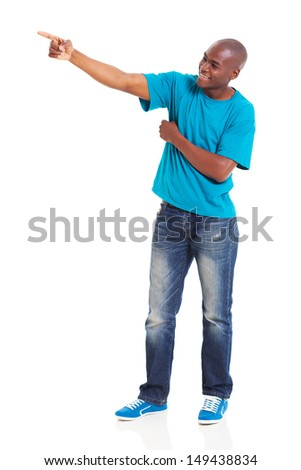 young african man pointing at copy space against white background - stock photo