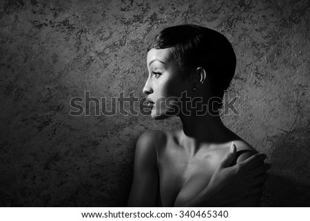 Young African model posing nude in black and white - stock photo