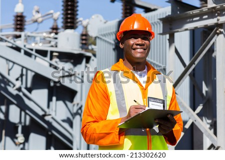young african technician working in electrical substation - stock photo