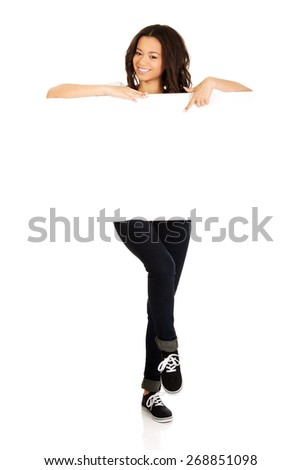 Young african teen pointing on blank board. - stock photo