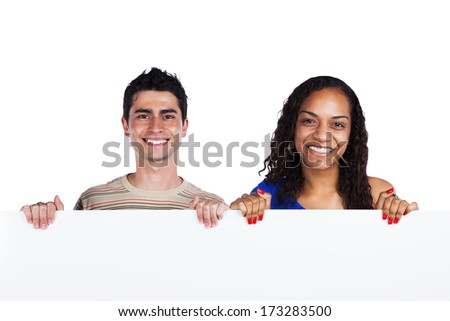 Young african woman and caucasian man holding a blank white placard (isolated on white) - stock photo