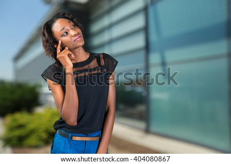 Young african woman, businesswoman thinking