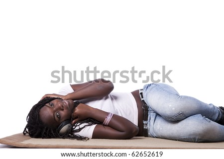 young african woman listening to music (isolated on white) - stock photo
