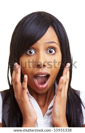 Young african woman looking shocked into the camera - stock photo