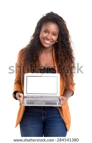 Young african woman presenting your product on a laptop computer - stock photo