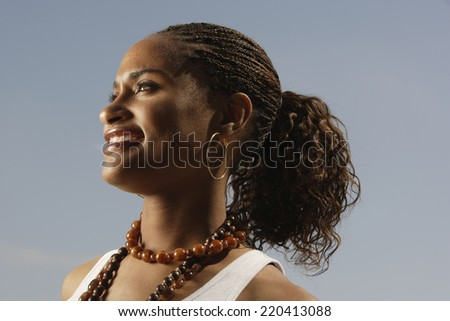 Young African woman smiling - stock photo