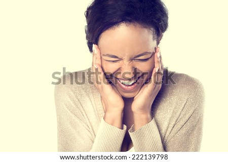 Young African woman smiling holding hands near her face - stock photo