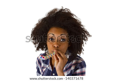 Young african woman with Partyhorn - isolated on whtie background - stock photo