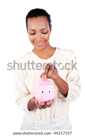 Young Afro-american businesswoman saving money in a piggybank against a white background - stock photo