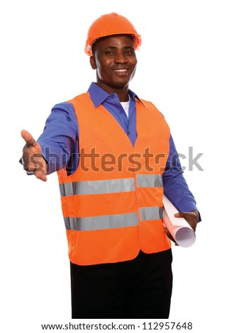 Young Afro-American engineer with blueprints giving his hand isolated on white - stock photo