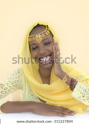 Young Afro beauty dressed for a celebration - stock photo