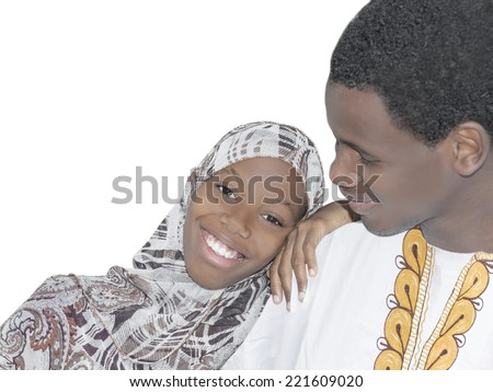 Young Afro couple showing love and affection, isolated  - stock photo