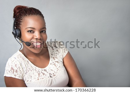 Young agent Call Center laughing while talking - stock photo