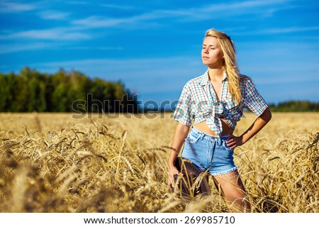 Young american cowgirl woman portrait outdoors - stock photo