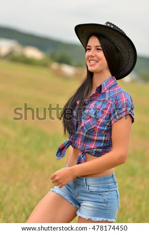 Young american cowgirl woman portrait outdoors.