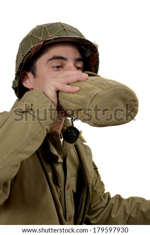 young american soldier drink  water in canteen