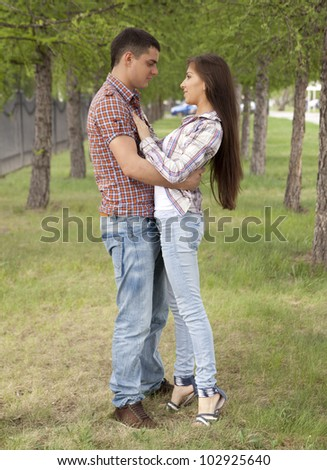 young amorous couple embracing  in park