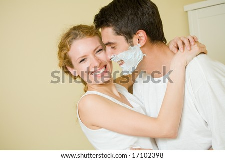 Young amorous couple having a fun together at home - stock photo