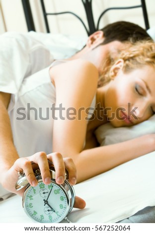 Young amorous couple waking up at the morning