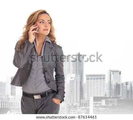 Young and attractive business woman over city background - stock photo