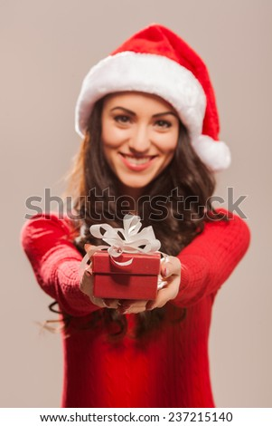 Young and attractive girl with Christmas gift