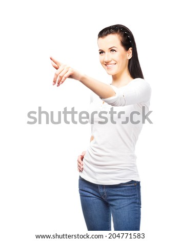 Young and attractive teenage girl pressing imaginary button isolated on white