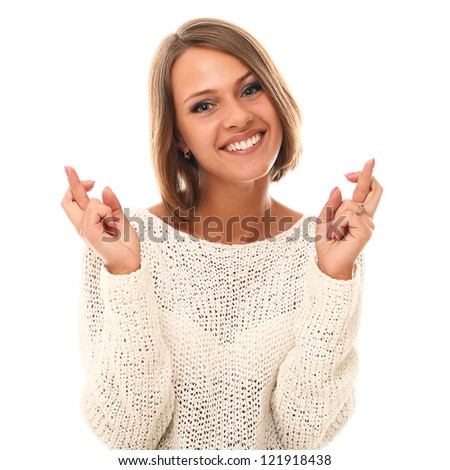 Young and attractive woman crossing fingers over a white background - stock photo