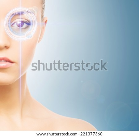 Young and attractive woman from future with the laser hologram on her eyes (collage about eye scanning technology) - stock photo