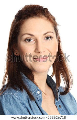 Young and attractive young woman standing against a white background wearing black jeans and a jeans shirt, Feeling great. - stock photo