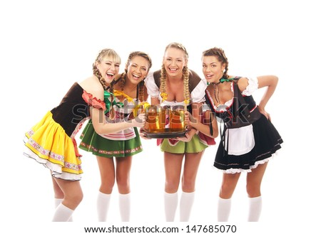 Young and beautiful bavarian girls isolated over white background - stock photo