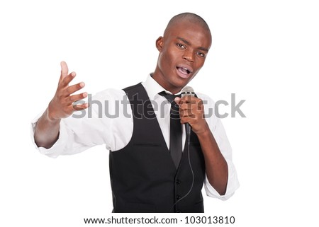 young and beautiful black man holding a microphone and singing - stock photo