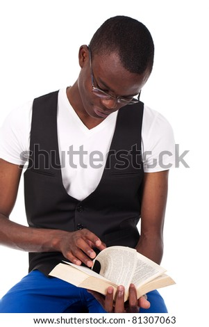young and beautiful black man reading a book - stock photo