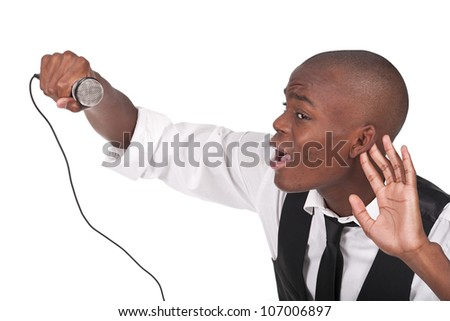 young and beautiful black man singing with his hand behind the ear