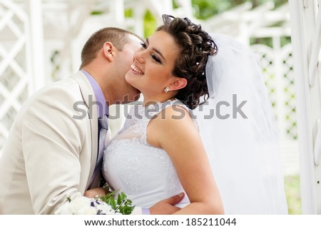 Young and beautiful bride and groom smilling - stock photo