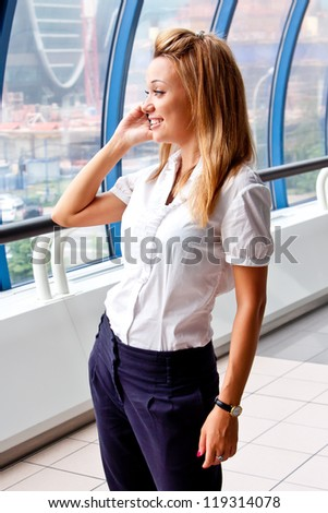 Young and beautiful business woman on the phone