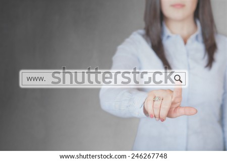 Young and beautiful Businesswoman pushing (touching) virtual web browser address bar or search bar with loupe sign - stock photo