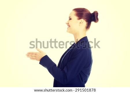 Young and beautiful businesswoman welcoming - stock photo