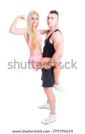 Young and beautiful couple of fitness trainers posing isolated on studio white background - stock photo