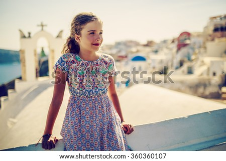 Young and beautiful girl in Oia - Santorini, Greece