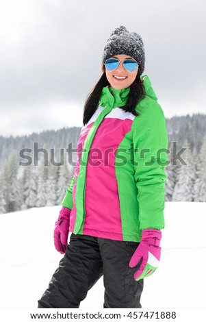 young and beautiful girl posing and enjoying the snow