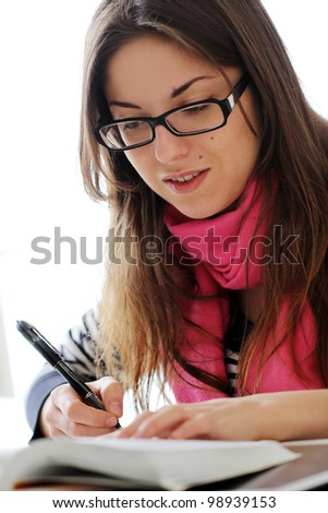 Young and Beautiful girl studying at home