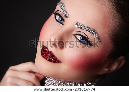 Young and Beautiful girl with professional Makeup