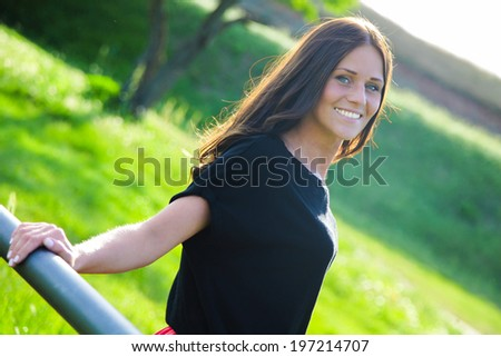 Young and beautiful lady is smiling and enjoying nice weather