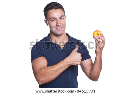 young and beautiful man holding a red apple and making ok sign - stock photo