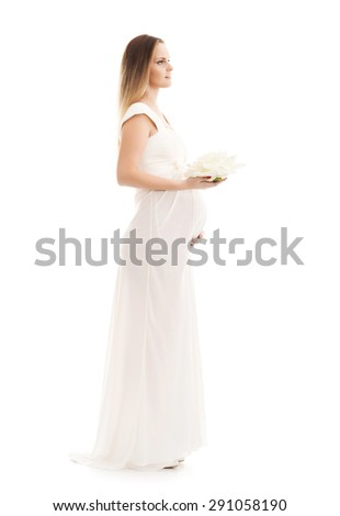 Young and beautiful pregnant woman in antique dress over grey background with a lot of blank space - stock photo
